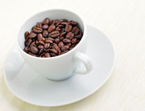 Coffee bean in cup Stock Image