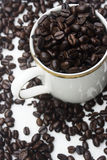Coffee bean cup. A cup of coffee, made from the coffee bean.  This is a graphical representation of coffee and the pleasure it brings people Royalty Free Stock Image