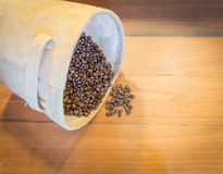 Coffee bean. Cup of coffee, bag and scoop on old rusty background Royalty Free Stock Images