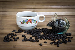 Coffee bean and cup of coffee Royalty Free Stock Image