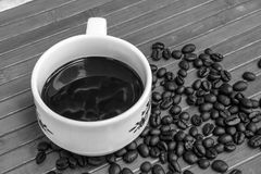 Coffee bean and cup of coffee Stock Images