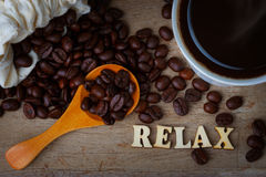 Coffee Bean WIth Cup of Coffee and Wood Alphabets Royalty Free Stock Photography