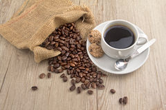 Coffee bean with a cup of kopi Stock Image