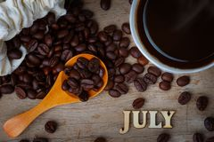 Coffee Bean WIth A Cup of Coffee and Wood Alphabets Stock Photo