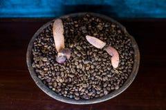 Coffee bean in earthenware jar on wooden table Stock Photo