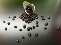 Coffee bean fall down from glass Royalty Free Stock Photos