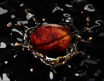 Coffee bean falling into a dark liquid, forming a crown splash, Royalty Free Stock Image