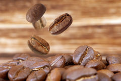 Coffee bean. Are falling on wood floor royalty free stock photos