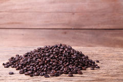 Coffee bean. Fresh coffee beans on wood, ready to brew delicious coffee Royalty Free Stock Photography