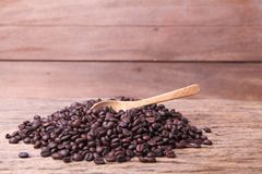 Coffee bean. Fresh coffee beans on wood, ready to brew delicious coffee Stock Image