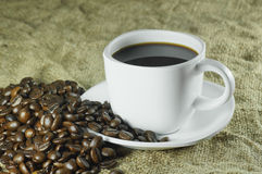Coffee Bean and Full Cup Coffee Stock Photo