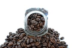 Coffee bean in glass bottle. Coffee bean in glass bottle isolated white background Stock Photography