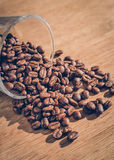 Coffee bean in glass. On wood table Royalty Free Stock Images