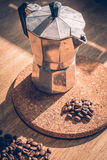 Coffee bean in glass. On wood table Royalty Free Stock Image
