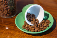 Coffee bean in a green ceramic cup Royalty Free Stock Images