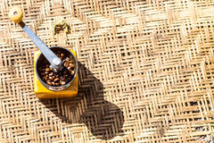 Coffee bean grinder on the wood Royalty Free Stock Image