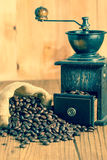 Coffee bean and grinder Stock Image