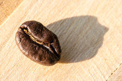 Coffee bean on grunge wooden Royalty Free Stock Images