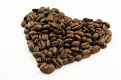 Coffee Bean Heart. Unground coffee beans shaped into a heart Stock Photography