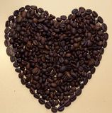 Coffee bean heart. Romantic heart made from roasted coffee beans Royalty Free Stock Image