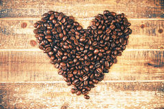 Coffee bean hearts. Coffee bean heart on wooden surface Stock Image