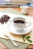 Coffee bean and hot coffee with green leaf Royalty Free Stock Images