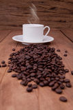 Coffee bean. Hot coffee on wooden background Stock Photography
