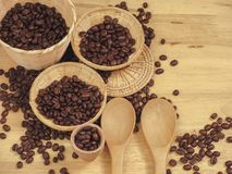 Coffee bean in little basket and spoon wood on slat wood stock photos