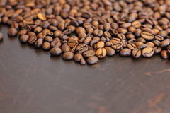 Coffee Bean. Many coffee bean on the brown wood table Stock Photo