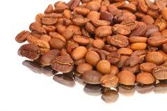 Coffee Bean on the mirror. White background Stock Photos