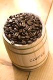 Coffee bean on oak drum Royalty Free Stock Images