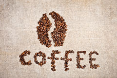 Coffee bean on old burlap canvas Royalty Free Stock Photos