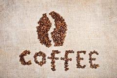 Coffee bean on old burlap canvas Royalty Free Stock Photos