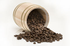 Coffee bean out of oak drum. On white background Royalty Free Stock Photo