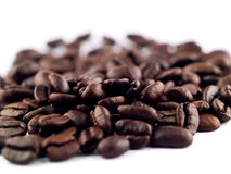 Coffee Bean Pile. A pile of coffee beans with a shallow depth of field keeping only a portion in focus Royalty Free Stock Photography