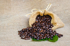 Coffee bean in sack bag on burlap background Royalty Free Stock Photography