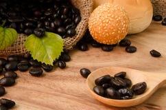 Coffee bean in sack Royalty Free Stock Photos