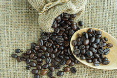 Coffee bean scatter from a jute bag Royalty Free Stock Photography