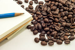 Coffee Bean with Sketchbook Stock Images