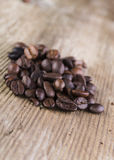 Coffee bean spilled on old plank. Roasted coffee bean spilled on old plank Royalty Free Stock Photography