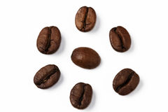 Coffee bean surrounded by other. Closeup of one coffee bean surrounded by other coffee beans stock photography