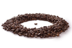 Coffee bean surrounded by other coffee beans Stock Photography