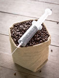 Coffee bean and syringe Royalty Free Stock Image