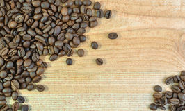 The Coffee Bean. On Wood Background Royalty Free Stock Photos
