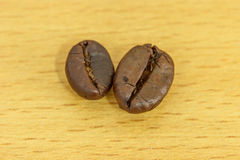 Coffee bean on wood background Royalty Free Stock Photo