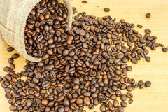 Coffee bean on wood background Royalty Free Stock Images