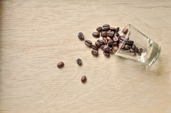 Coffee bean on wood background Stock Images