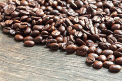 Coffee bean on wood background. Royalty Free Stock Photography