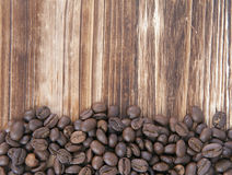 Coffee bean. On wood floor royalty free stock images