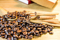 Coffee bean on wood scoop on wooden background Stock Image